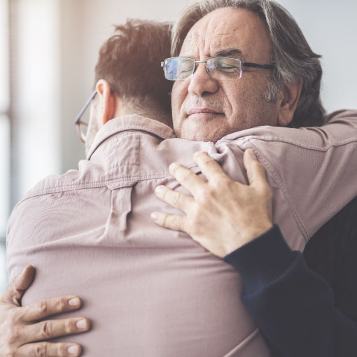 image of father and son hugging