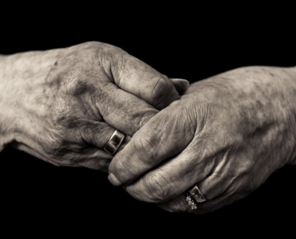 clasped hands after unattended death