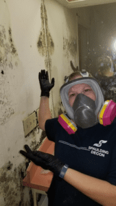 spaulding decon technician cleaning up mold
