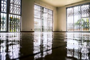 an empty room with standing water in it